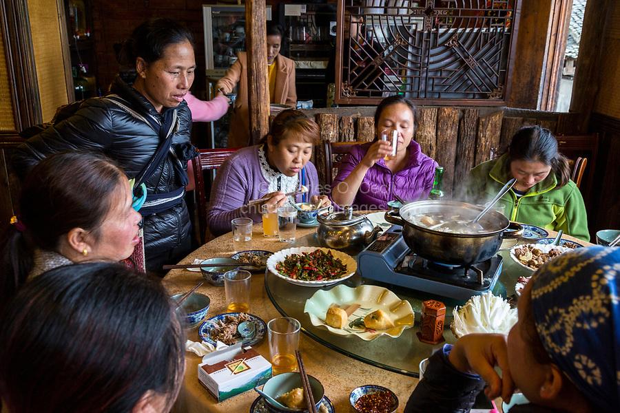 Longji, China.  Chinese Women Having Lunch.