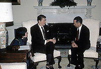Washington DC., USA, APril 10, 1984<br /> President Ronald Reagan with Salvador Jorge Blanco the President of the Dominican Republic in the Oval Office. Credit: Mark Reinstein/MediaPunch