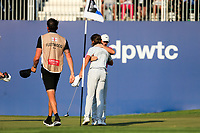 Tommy Fleetwood (ENG) and Rory McIlroy (NIR) on the 18th green during the final round of the DP World Tour Championship, Jumeirah Golf Estates, Dubai, United Arab Emirates. 24/11/2019<br /> Picture: Golffile | Fran Caffrey<br /> <br /> <br /> All photo usage must carry mandatory copyright credit (© Golffile | Fran Caffrey)