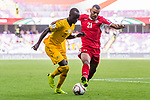 Awer Mabil of Australia (L) fights for the ball with Salem Alajalin of Jordan (R) during the AFC Asian Cup UAE 2019 Group B match between Australia (AUS) and Jordan (JOR) at Hazza Bin Zayed Stadium on 06 January 2019 in Al Ain, United Arab Emirates. Photo by Marcio Rodrigo Machado / Power Sport Images