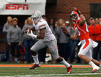 Ohio State Buckeyes safety C.J. Barnett (4) runs away from Illinois Fighting Illini wide receiver Spencer Harris (80) after an interception during the NCAA football game at Illinois on Saturday, November 16, 2013. (Columbus Dispatch photo by Barbara J. Perenic)