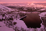 A crimson sunset behind the Sierra Nevada at Red Lake during winter, Calif.