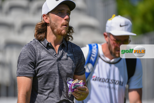 Tommy Fleetwood (ENG) eats a sandwich as he heads down 10 during 3rd round of the World Golf Championships - Bridgestone Invitational, at the Firestone Country Club, Akron, Ohio. 8/4/2018.<br /> Picture: Golffile   Ken Murray<br /> <br /> <br /> All photo usage must carry mandatory copyright credit (© Golffile   Ken Murray)
