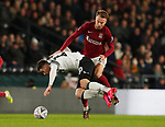 Tom Lawrence of Derby County tussles with Chris Lines of Northampton during the FA Cup match at the Pride Park Stadium, Derby. Picture date: 4th February 2020. Picture credit should read: Darren Staples/Sportimage
