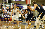 SIOUX FALLS, SD, FEBRUARY 10:  Zach Wessels #11 from the University of Sioux Falls drives against Jordan Spencer #23 from Augustana Friday night at the Stewart Center in Sioux Falls. (Photo by Dave Eggen/Inertia)