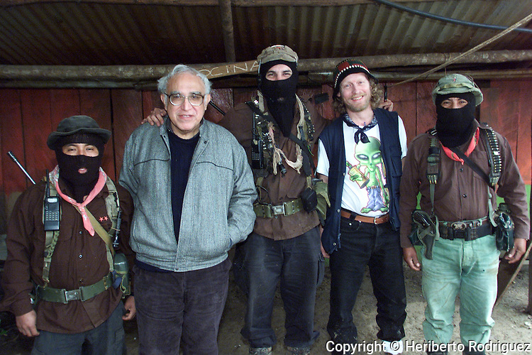 File picture of Mexican writer Carlos Monsivais and Subcomandante Marcos, Mayor Moises, Hermann Bellinghausen,  and Comandante Tacho  in La Realidad village in southern state of Chiapas, December 2000. Monsivais died today at age 72. Photo by Heriberto Rodriguez