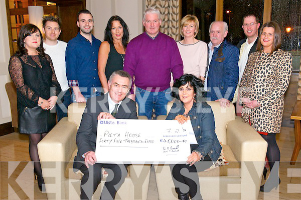 Marie O'Carroll presented a cheque for €45000 to Kieran Brady from Pieta House on behalf of Nathan's Walk Darkness in to Light in The Brehon Hotel, Killarney last friday evening. Pictured with L-R Eileen O'Donoghue, Simon Gallivan, Kevin O'Callaghan, Marese Kearney, Kevin O'Donoghue, Sheile O'Donoghue, Denis O'Carroll, Martin Driver and Sinead Driver.