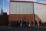 Supporters making their way along Gresty Road, Crewe, the home of Crewe Alexandra before their home game against Leyton Orient in the SkyBet League One. The match was won by the visitors from London by 2-1 with two goals on debut by Chris Dagnall, sending Orient to the top of the league. The match was watched by 4830 spectators.
