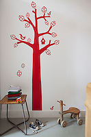 "In this children's bedroom is a ""Bird Tree"" wall sticker from Ferm Living"