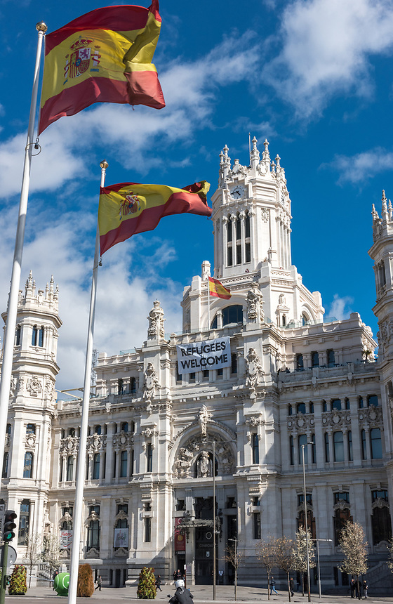 MADRID, SPAIN - 30th March 2016: A banner welcoming refugees hangs from the Cybele Palace, Madrid's City Hall