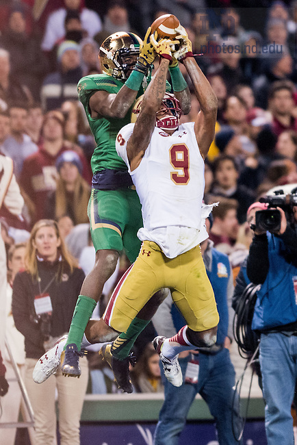 Nov. 21, 2015; Irish wide receiver Chris Brown (2) catches a pass for a touchdown as Boston College Eagles defensive back John Johnson (9) defends in the third quarter at Fenway Park. (Photo by Matt Cashore)