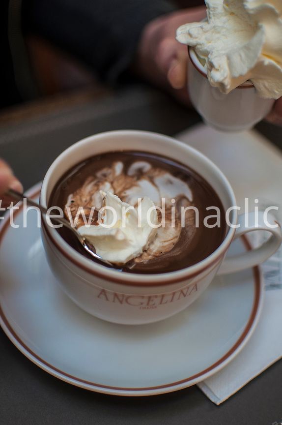 FRANCE, Paris, a hot chocolate drink and whipped cream in Angelina Cafe