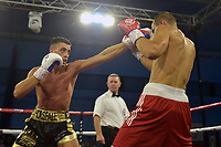 Sam Horsfall (black/gold shorts) defeats Pjotr Filatov during a Boxing Show at Bracknell Leisure Centre on 8th July 2018