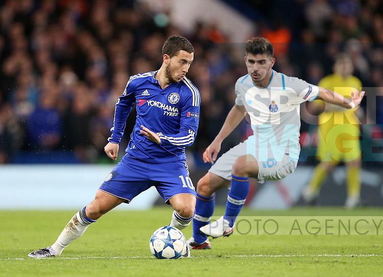 Chelsea's Eden Hazard tussles with Porto's Ruben Neves<br /> <br /> UEFA Champions League - Chelsea v FC Porto - Stamford Bridge - England - 9th December 2015 - Picture David Klein/Sportimage