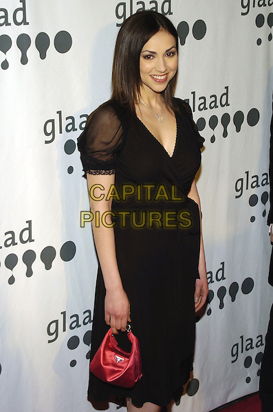 EDEN RIEGEL.Attending the GLAAD Media Awards (Gay and Lesbian Alliance Against Defamation) New York at the Mariott Marquis Hotel, New York City, NY, USA.March 26th, 2007.half length black dress red bag purse sheer sleeves.CAP/ADM/BL.©Bill Lyons/AdMedia/Capital Pictures *** Local Caption ***