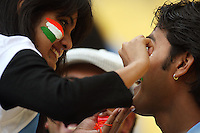 Indian fans apply face paint before the match during 2nd Twenty20 cricket match match between New Zealand Black Caps and West Indies at Westpac Stadium, Wellington, New Zealand on Friday, 27 February 2009. Photo: Dave Lintott / lintottphoto.co.nz