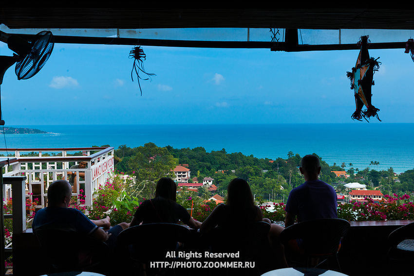 Silhouettes of people relaxing in bar on observation deck Lamai view point, Samui, Thailand