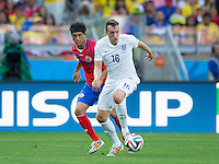 Phil Jones of England and Christian Bolanos of Costa Rica