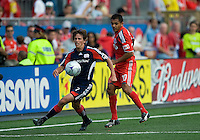 23 May 09: New England Revolution midfielder Wells Thompson #7 and Toronto FC midfielder Amado Guevara #20 in action during a game between the New England Revolution and Toronto FC.Toronto FC won 3-1.