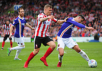 Exeter City's Lloyd James shields the ball from Lincoln City's Harry Anderson<br /> <br /> Photographer Andrew Vaughan/CameraSport<br /> <br /> The EFL Sky Bet League Two Play Off First Leg - Lincoln City v Exeter City - Saturday 12th May 2018 - Sincil Bank - Lincoln<br /> <br /> World Copyright &copy; 2018 CameraSport. All rights reserved. 43 Linden Ave. Countesthorpe. Leicester. England. LE8 5PG - Tel: +44 (0) 116 277 4147 - admin@camerasport.com - www.camerasport.com