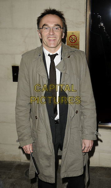 DANNY BOYLE.Jameson Empire Film Awards 2009 at the Grosvenor House Hotel, Park Lane, London, England..March 29th 2009 .half 3/4 length beige trench coat glasses .CAP/CAN.©Can Nguyen/Capital Pictures.