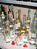 ITALY, Soave,  a selection of Grappa kept on table in restaurant Groto de Corgnan Restaurant.