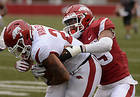 NWA Democrat-Gazette/ANDY SHUPE<br /> Arkansas running back Devwah Whaley (left) carries the ball Saturday, April 6, 2019, as defensive back Simeon Blair reaches to make the tackle during the Razorbacks' spring game in Razorback Stadium in Fayetteville. Visit nwadg.com/photos to see more photographs from the game.