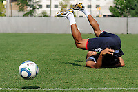 New York Red Bulls Thierry Henry (14) laughs as he falls over backward going for a ball during a New York Red Bulls practice on the campus of Montclair State University in Upper Montclair, NJ, on July 16, 2010.