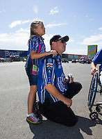 Jul. 27, 2014; Sonoma, CA, USA; NHRA funny car driver Robert Hight and his daughter Autumn Hight during the Sonoma Nationals at Sonoma Raceway. Mandatory Credit: Mark J. Rebilas-