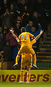 Motherwell's Michael Higdon is congratulated by Keith Lasley after he scores Motherwell's fourth goal .