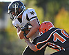 West Hempstead running back No. 44 Vinny Messina fights for yards during the fourth quarter of a Nassau County Conference IV varsity football game against host East Rockaway High School on Saturday, October 10, 2015. He ran for two touchdowns in West Hempstead's 28-14 win.<br /> <br /> James Escher