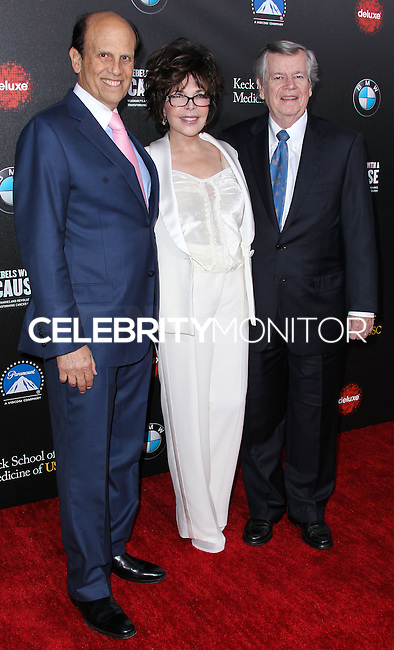 HOLLYWOOD, LOS ANGELES, CA, USA - MARCH 20: Michael Milken, Carole Bayer Sager, Robert A. Daly at the 2nd Annual Rebels With A Cause Gala Honoring Larry Ellison held at Paramount Studios on March 20, 2014 in Hollywood, Los Angeles, California, United States. (Photo by Xavier Collin/Celebrity Monitor)