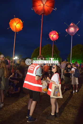 Latitude Festival, Henham Park, Suffolk, UK July 2019. Solar umbrella llights & Helpful Arena Team
