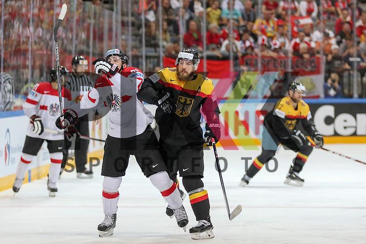 Deutschlands Reimer, Patrick (Nr.37)(Nuernberg Ice Tigers) mit einem Check  im Spiel IIHF WC15 Deutschland vs. Oestereich.<br /> <br /> Foto &copy; P-I-X.org *** Foto ist honorarpflichtig! *** Auf Anfrage in hoeherer Qualitaet/Aufloesung. Belegexemplar erbeten. Veroeffentlichung ausschliesslich fuer journalistisch-publizistische Zwecke. For editorial use only.