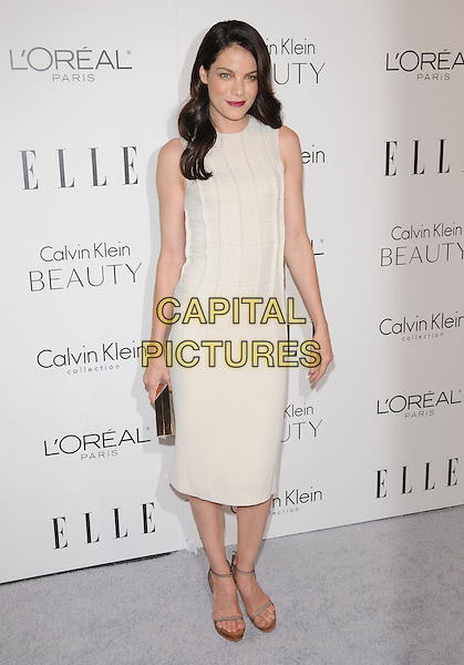 MICHELLE MONAGHAN .walks the carpet as Elle Honors Hollywood's Most Esteemed Women in the 17th Annual Women in Hollywood Tribute held at The Four Seasons Beverly Hills in Beverly Hills, California, USA, October 18th 2010..full length white cream sleeveless mid dress    platform sandals gold clutch bag                .CAP/RKE/DVS.©DVS/RockinExposures/Capital Pictures.