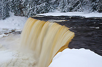 A close-up shot of the unusual streaks of waters at Tahquamenon Falls.