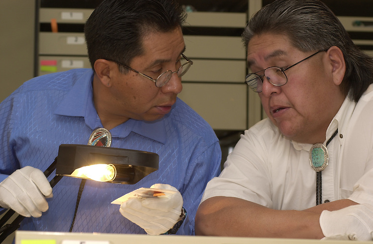 15720Kennedy Museum examining southwest Native American Collection