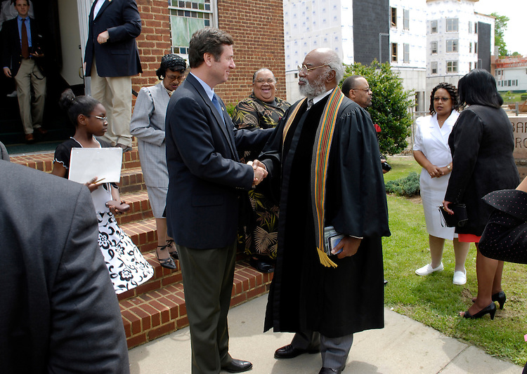 Sen. George Allen, R-Va., shakes hands with the former Pastor of First Baptist, Rev. J. Samuel Williams, Jr., after Sunday Service. The Faith and Politics Institute lead a delegation to observe how residents of Farmville, Va. are dealing with racial integration; Prince Edward county closed its public schools from 1959 to 1964 instead on integrating them. The Institute organized a three-day symposium, focusing on the history of the region, particularly with the participants of a 1951 African-American student walkout over their school's terrible conditions - which eventually became a lawsuit that was decided as part of the landmark Brown v. Board of Education case. At that time, Rev. Leslie Francis Griffin of First Baptist served as an outspoken leader for the students.