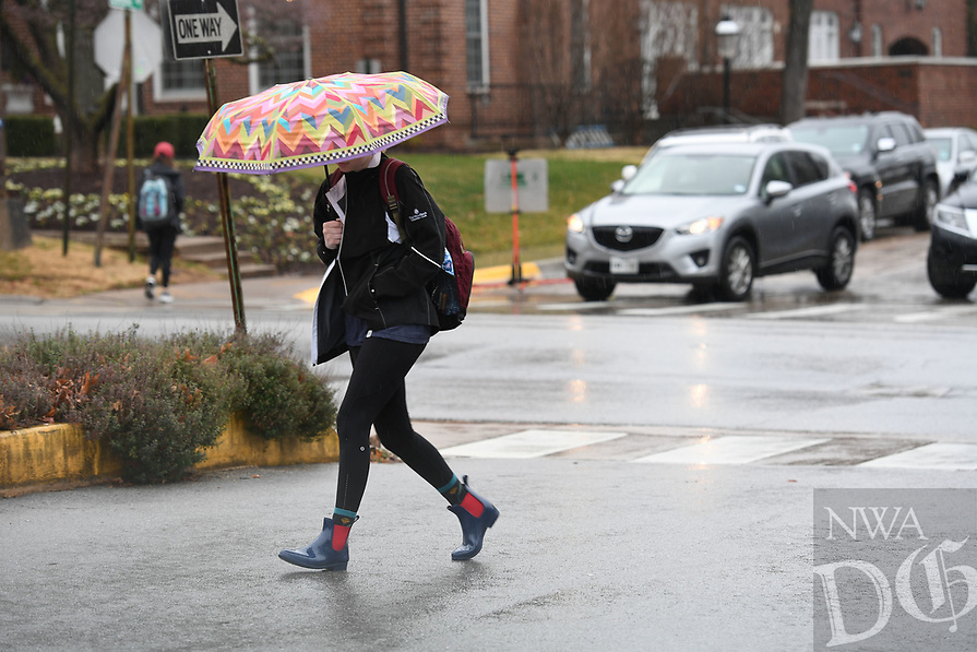 NWA Democrat-Gazette/J.T. WAMPLER A pedestrian walks in the rain Wednesday Feb. 6, 2019 at the University of Arkansas in Fayetteville. The National Weather Service is calling for the rain to go away and frigid temperatures to resume with lows in the teens Friday and Saturday.