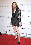 """Milla Jovovich  attends the Art of Elysium 4th Annual Charity Gala """"Heaven"""" held at The Annenberg Building at The California Science Center in Los Angeles, California on January 15,2011                                                                               © 2010 DVS / Hollywood Press Agency"""
