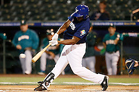 21 September 2012: Sneideer Santos hits the ball during France vs South Africa tie game 2-2, rain delayed at the end of the 9th inning at 1 AM, during the 2012 World Baseball Classic Qualifier round, in Jupiter, Florida, USA. Game to resume 22 September 2012 at noon.