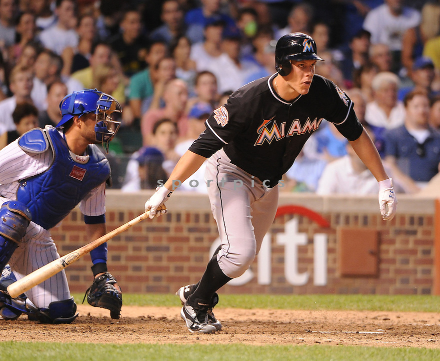 LOGAN MORRISON (5) of the Miami Marlins in action during the Marlins game against the Chicago Cubs on July 18, 2012 at Wrigley Field in Chicago, IL. The Cubs beat the Marlins 5-1.