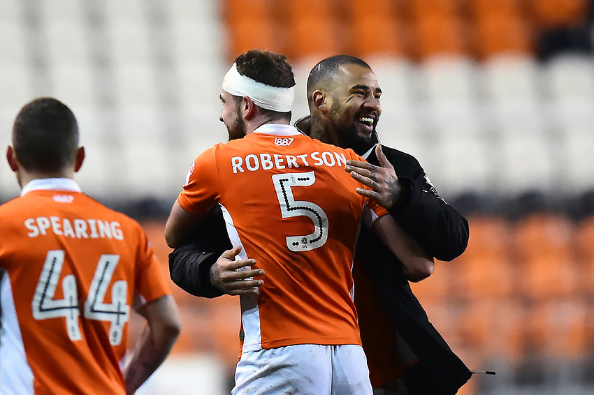 Blackpool's Kyle Vassell celebrates with team-mate Clark Robertson at the end of the match<br /> <br /> Photographer Richard Martin-Roberts/CameraSport<br /> <br /> The EFL Sky Bet League One - Blackpool v Charlton Athletic - Tuesday 13th March 2018 - Bloomfield Road - Blackpool<br /> <br /> World Copyright &not;&copy; 2018 CameraSport. All rights reserved. 43 Linden Ave. Countesthorpe. Leicester. England. LE8 5PG - Tel: +44 (0) 116 277 4147 - admin@camerasport.com - www.camerasport.com