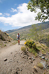 Woman walking in the the River Rio Poqueira gorge valley, High Alpujarras, Sierra Nevada, Granada Province, Spain