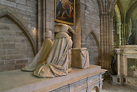 Kneeling figures on top of the funerary monument of Louis XII, 1462-1515, and Anne of Brittany, 1477-1514, made 1516-31 in Carrara marble by Giovani di Giusto Betti, 1479-1519, in the Basilique Saint-Denis, Paris, France. The mausoleum resembles an antique temple and is surrounded by the 12 apostles and the 4 cardinal virtues, Prudence, Might, Justice and Temperance and the plinth is decorated with bas-reliefs of the Italian wars. The basilica is a large medieval 12th century Gothic abbey church and burial site of French kings from 10th - 18th centuries. Picture by Manuel Cohen