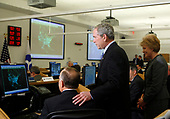 United States President George W. Bush listens to Scott Hubbard, a staff member at the US Department of Transportation, during a visit to the department with US Secretary of Transportation Mary E. Peters on November 18, 2008, Washington DC. He previously made remarks on Aviation Congestion and Transportation Safety.<br /> Credit: Aude Guerrucci / Pool via CNP
