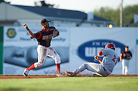 Batavia Muckdogs second baseman Giovanny Alfonzo (8) throws to first as David Kerian (21) slides in during a game against the Auburn Doubledays July 10, 2015 at Dwyer Stadium in Batavia, New York.  Auburn defeated Batavia 13-1.  (Mike Janes/Four Seam Images)