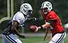Sam Darnold #14 of the New York Jets, right, hands off to George Atkinson #34 during Training Camp at the Atlantic Health Jets Training Center in Florham Park, NJ on Tuesday, Aug. 7, 2018.