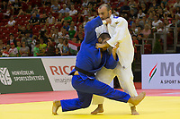 Krisztian Toth (in blue) of Hungary and Ushangi Margiani (in white) of Georgia fight during the Men -90 kg category at the Judo Grand Prix Budapest 2018 international judo tournament held in Budapest, Hungary on Aug. 12, 2018. ATTILA VOLGYI