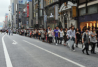 A long queue outside the newly opened H&M store in Ginza district, Tokyo, Japan. H&M plans to open its second Japan store in November, in Tokyo's fashionable Harajuku district, where it will feature a collection created for H&M by Japanese designer Rei Kawakubo of Comme des Garcons Ltd..